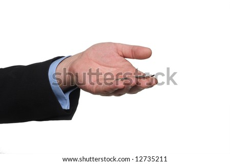 cropped shot of human hand in black suit holding out house keys