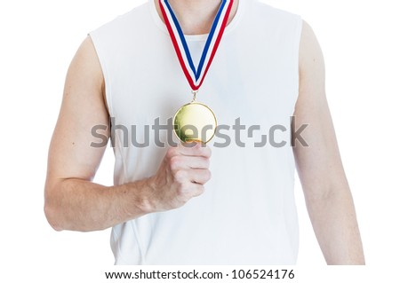 Cropped torso of man holding blank sports gold medal. - stock photo