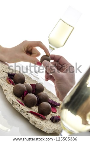 Cropped view of a couple sharing a chocolate candy. - stock photo