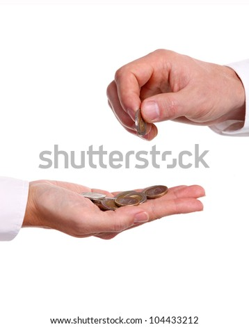 Cropped view of a male hand giving a euro coin to another person - stock photo