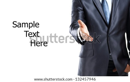 Cropped view of business man extending hand to shake - stock photo
