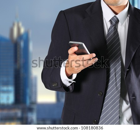 Cropped view of Businessman holding the phone - stock photo