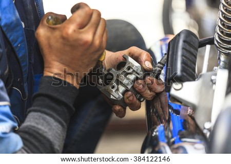 Cropped view of Motorcycle mechanic,Technician  - stock photo