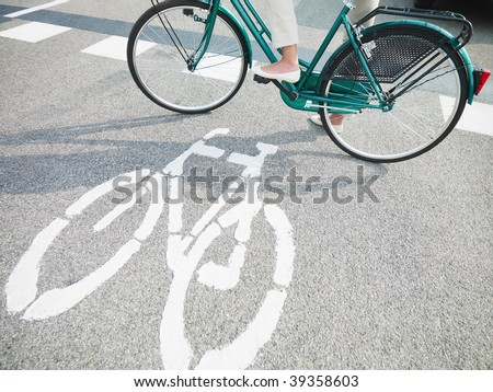 cropped view of woman commuting on bicycle. Copy space - stock photo