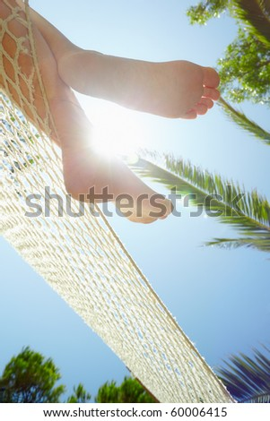 cropped view of woman relaxing on hammock. Low angle view, Vertical shape - stock photo