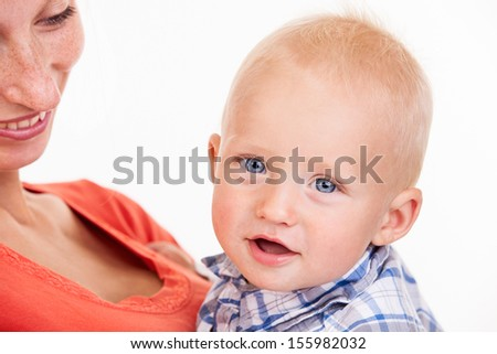 Cropped view of young Caucasian woman and her baby son over white - stock photo
