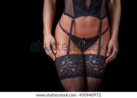 Cropped woman's body in underwear isolated on black background.