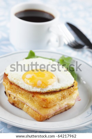 Croque madame sandwich with coffee