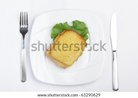 Croque-monsieur sandwich on white plate. Top view - stock photo