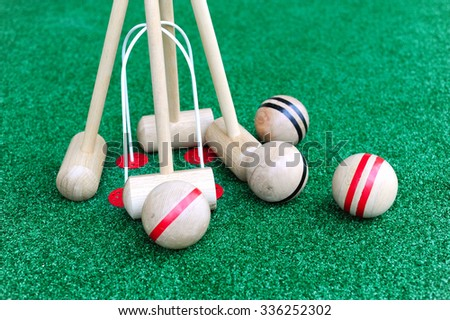 Croquet game Mallets and balls - stock photo