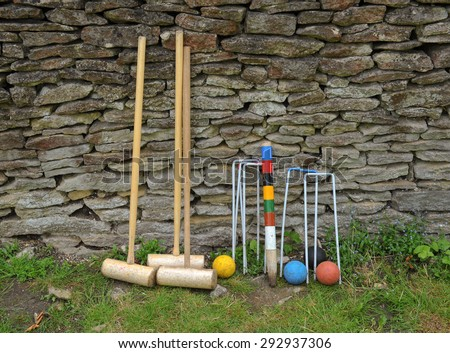 Croquet Set Resting Against a Dry Stone Wall at Dyrham Park, near Bath, Somerset, England, UK - stock photo