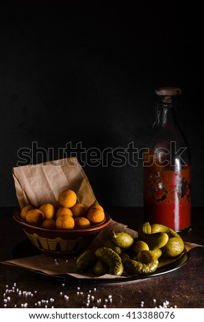 Croquettes and homemade ketchup, pickles, all homemade - stock photo