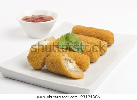Croquettes - Chicken and cheese croquettes served with chili sauce.
