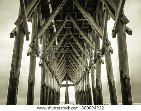 Cross Abstract. Cross at the end of a wooden boardwalk. - stock photo