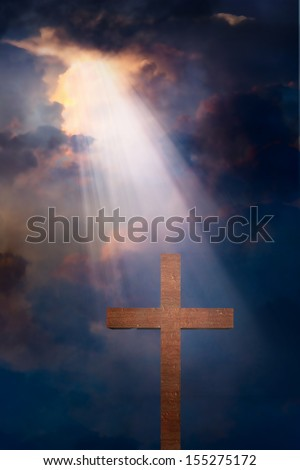 Cross and dramatic sky - stock photo