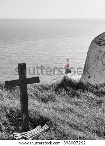 Cross and lighthouse at Beachy Head, United Kingdom - stock photo