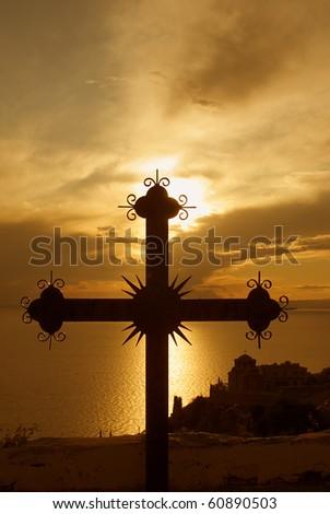 Cross at sunset on Mount Athos, Greece - stock photo