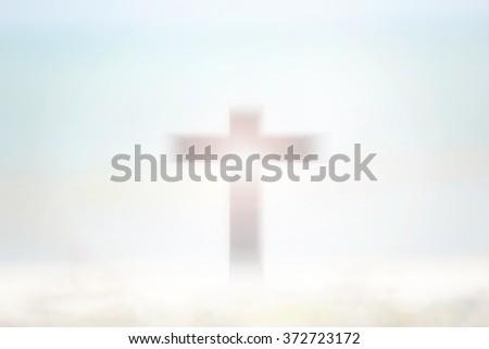 Cross Blurred on Beautiful Background. - stock photo