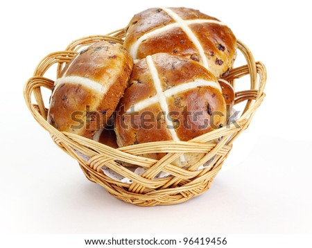 Cross buns.  Basket with fresh hot cross buns - stock photo