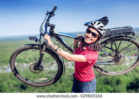 Cross country female biker relaxing after riding a bicycle race - stock photo