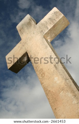 Cross from bottom in blue sky - stock photo