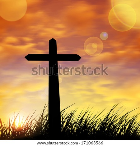 cross in a grass and sun,sunset background