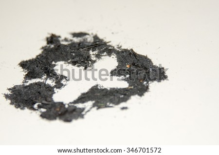 Cross in Ashes for Ash Wednesday - stock photo