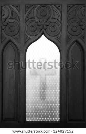 Cross in prayer of black and white photography - stock photo