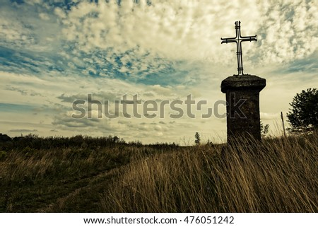 Cross In The Field Against The Sky