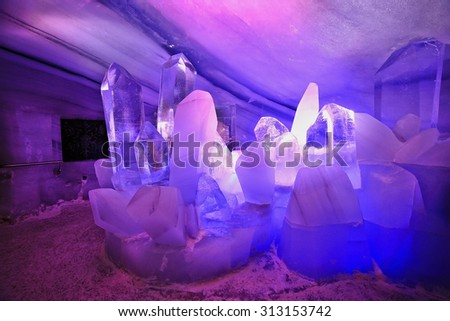 Cross inside the Natural Ice Palace (Ice Cave) at the top of Hintertux Glacier., Austria - stock photo