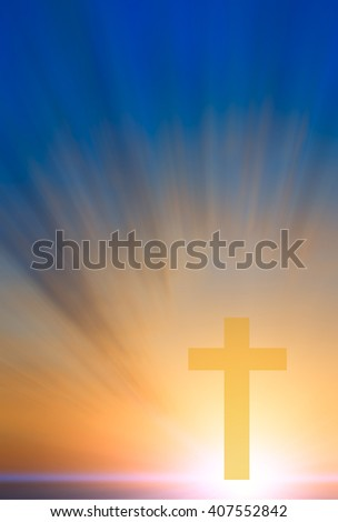 Cross of hope and faith in God and in the background rays of sunset and blue sky. religious abstract composition - stock photo
