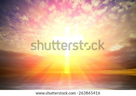Cross of hope and faith in God and in the background rays of sunset. religious composition - stock photo