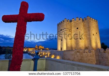 Cross of May, Roman Bridge, Mezquita Cathedral and Calahorra tower, Cordoba, Andalusia, Spain - stock photo