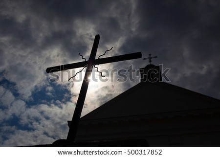 cross on a background of the sun and the church .