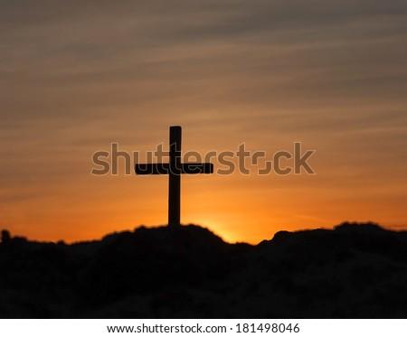 cross on Calvary and bright sunset - stock photo