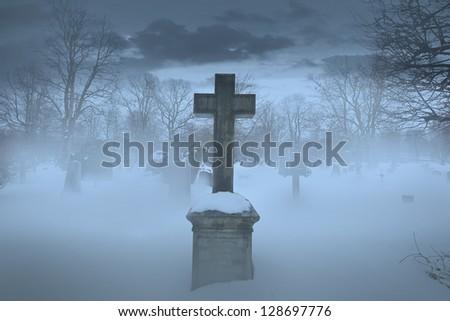 Cross on graveyard - stock photo