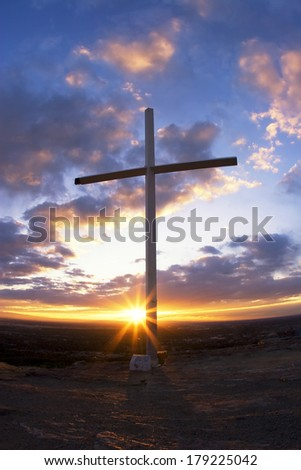 Cross on Table Rock overlooking Boise Idaho at sundown - stock photo