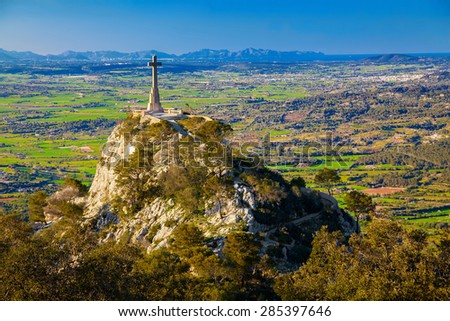 Cross on the hillside at the Santuario de San Salvador, Majorca, Spain - stock photo