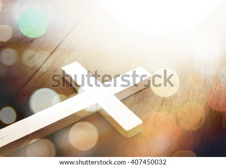 Cross on wood and bokeh background ,Christian god jesus religion concept - stock photo