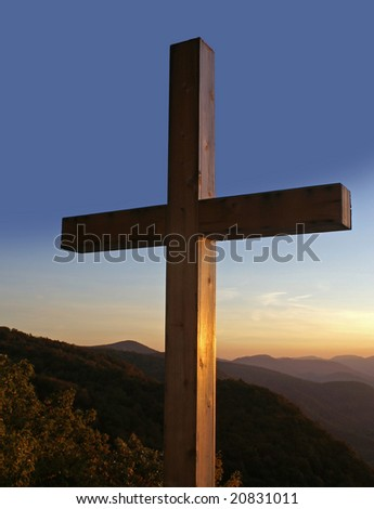 Cross overlooking the mountains at sunrise