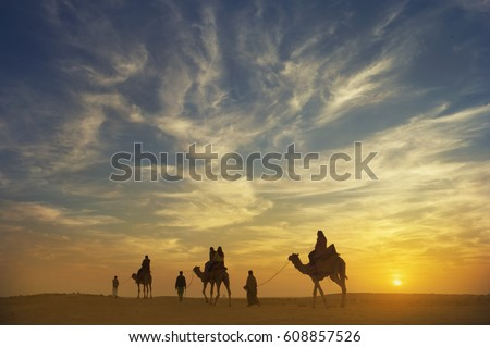 cross process filter of beautiful sunset at Thar desert with camel caravan,jaisalmer,india