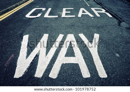 Cross processed clear way sign over the asphalt - stock photo
