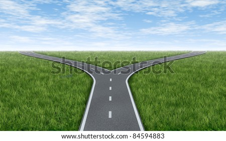 Cross roads horizon with grass and blue sky showing a  fork in the road  representing the concept of a strategic dilemma choosing the right direction to go when facing two equal or similar options. - stock photo