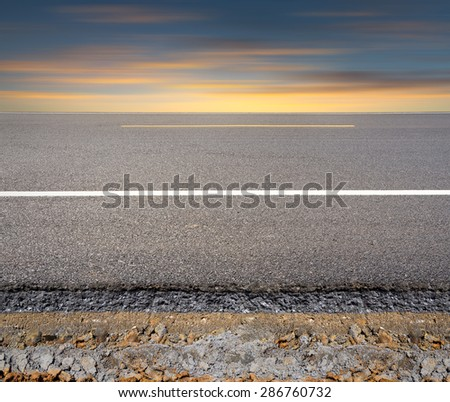Cross section of asphalt road with blue sky background. - stock photo