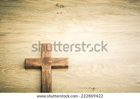 Cross shape on a wooden background.  / Cross background concept