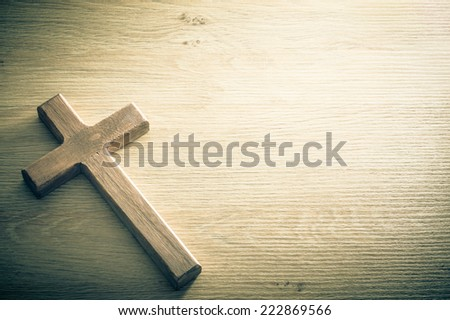 Cross shape on a wooden background. Large copy space available. / Cross background concept - stock photo