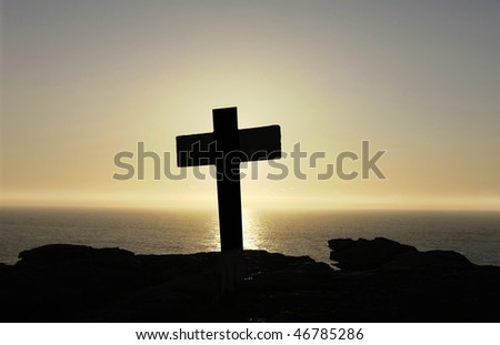 cross silhouette on top of the mountain - stock photo
