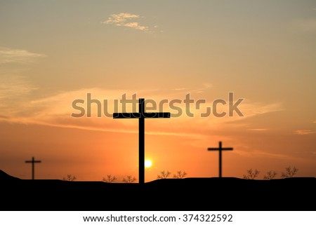 Cross silhouette. Sunset background.