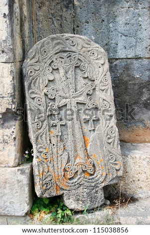 Cross-stones or khachkars at the 9th century Armenian monastery of Tatev. Khachkars are carved memorial stele, covered with rosettes and other patterns, unique art of Medieval Christian Armenia. - stock photo
