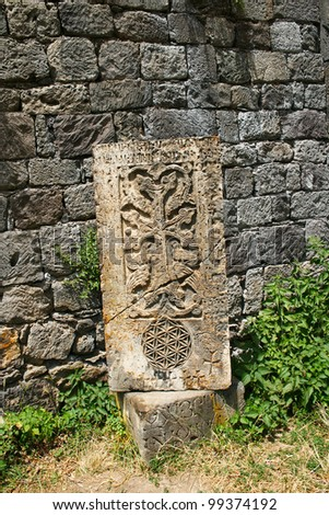 Cross-stones or khachkars at the 9th century Armenian monastery of Tatev. They are carved memorial stele, covered with rosettes and other patterns, unique art  of Medieval Christian Armenia.
